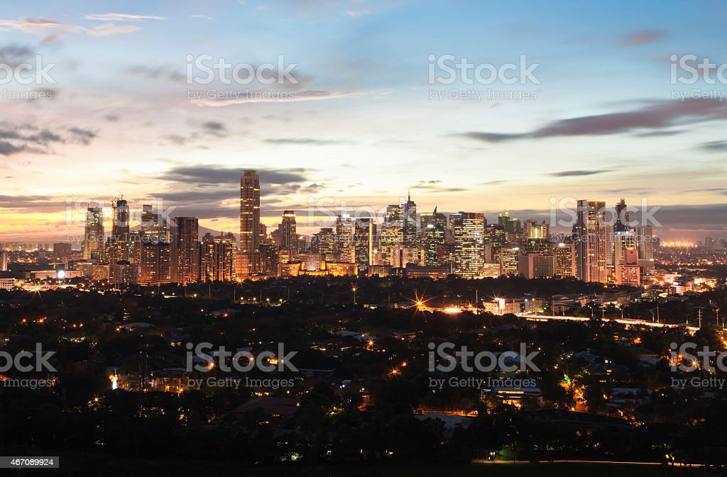 The lit up Manila skyline located in the Philippines stock photo