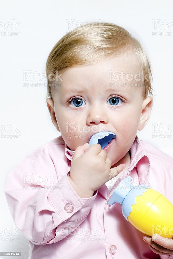 The little boy with Easter eggs on a white background royalty-free stock photo