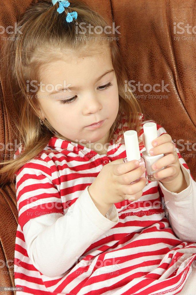 the little girl chooses nail varnish stock photo