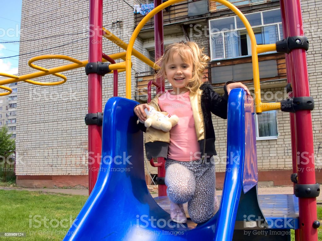The little girl in a baby swing stock photo