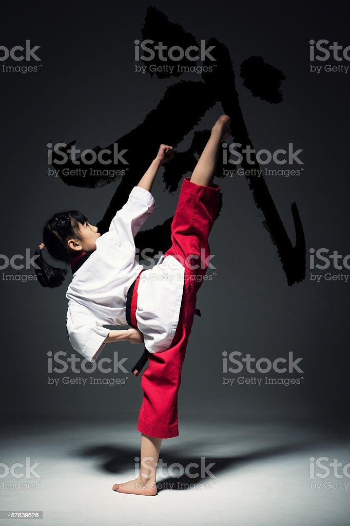 The little girl is practising Taekwondo. stock photo