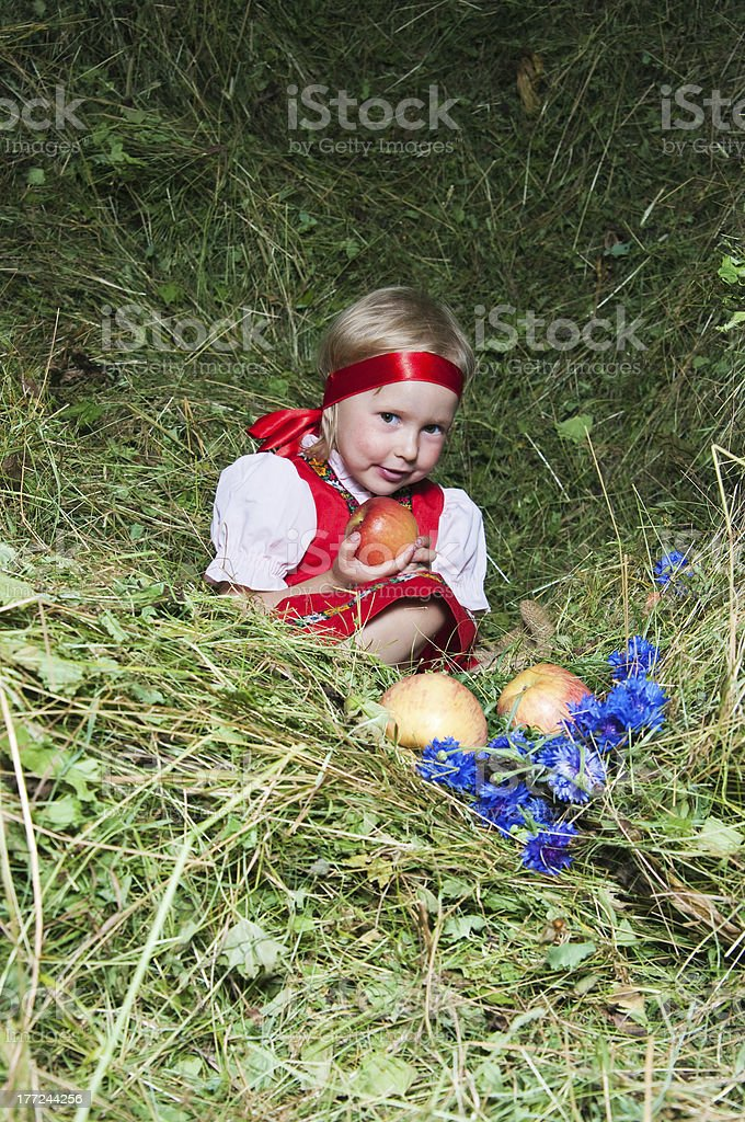 The little girl  on hay royalty-free stock photo