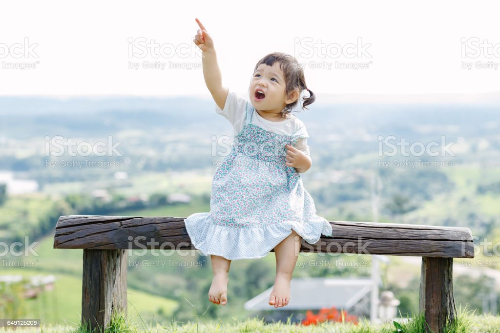 The little girl Running for fun in the garden stock photo
