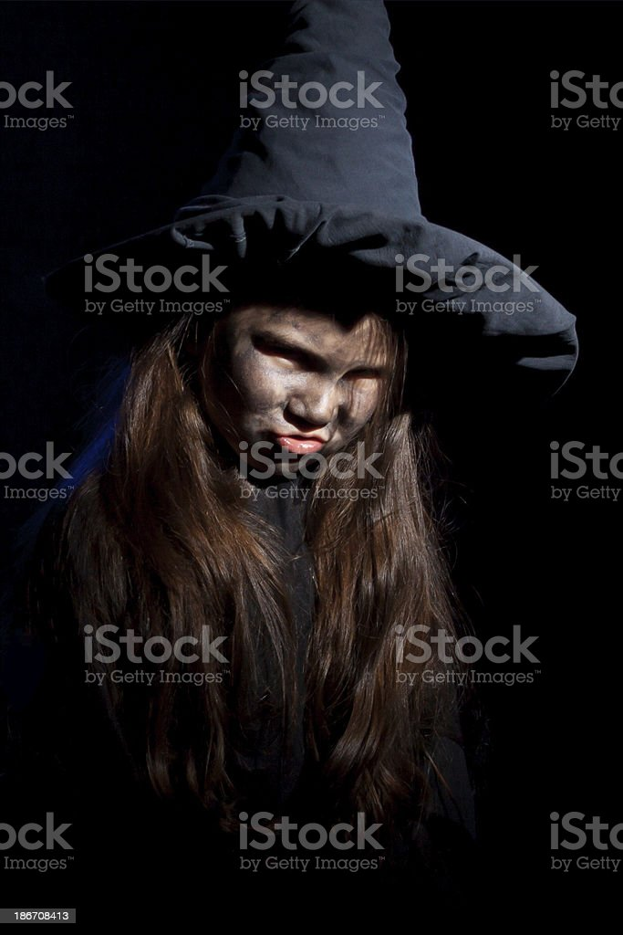The little witch with halloween pumpkin royalty-free stock photo