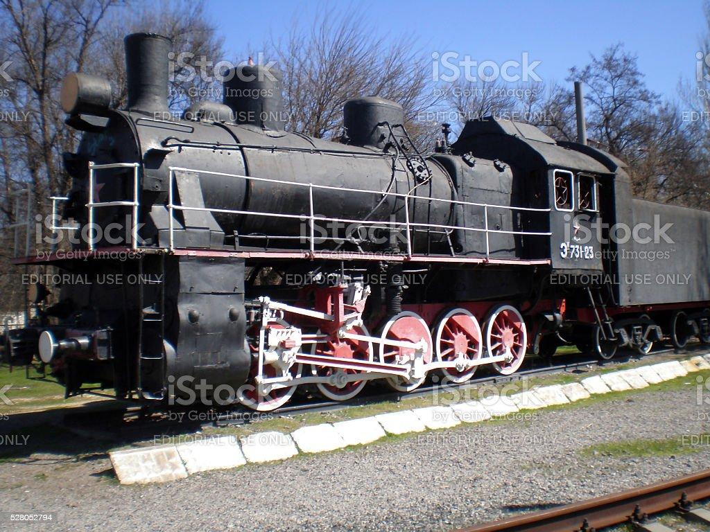 The locomotive Em-731-23 on a pedestal in Melitopol stock photo