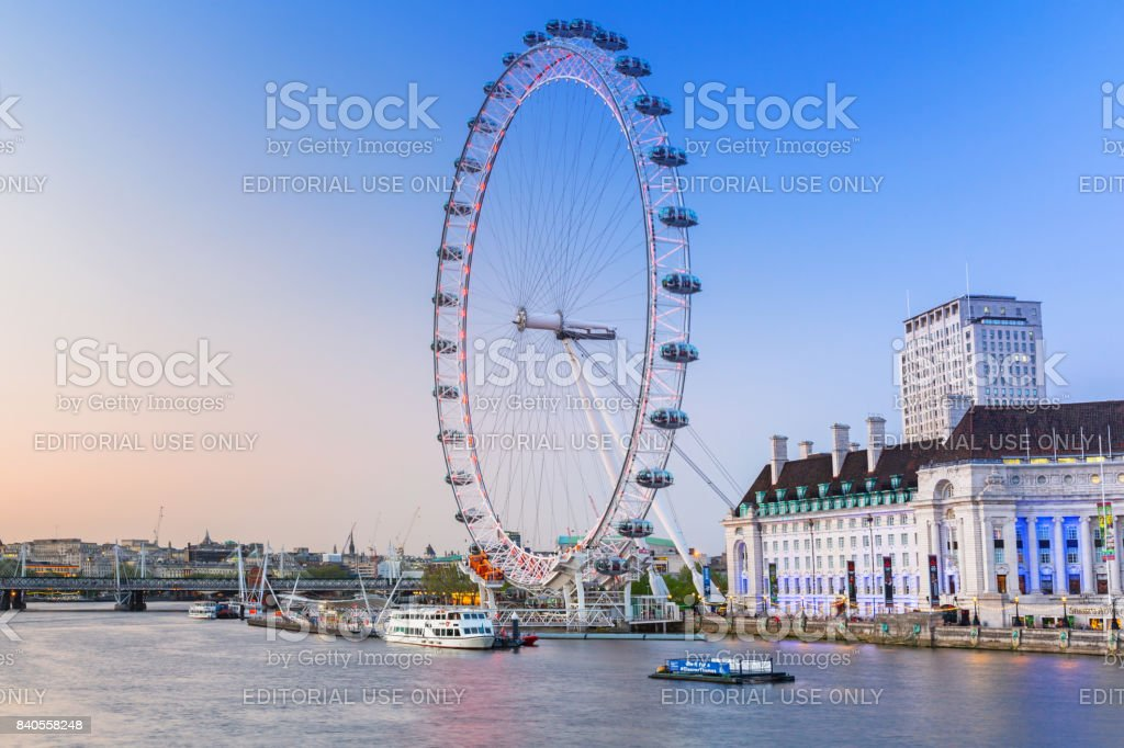 The London Eye near the River Thames  in London at dusk, England stock photo