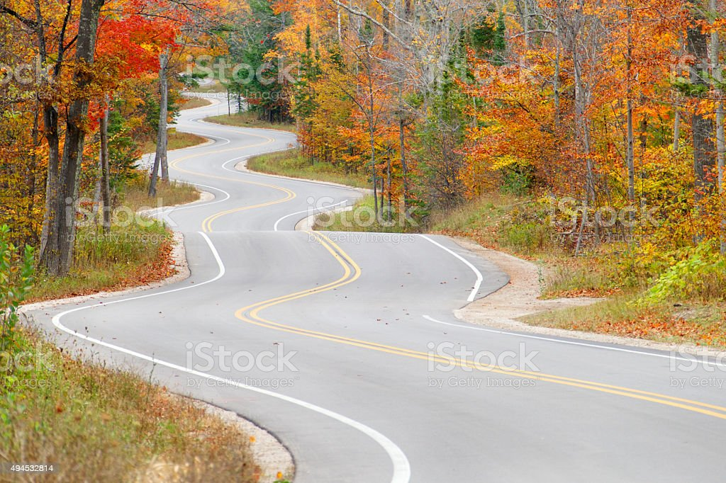The long and winding road through Autumn Splendor stock photo