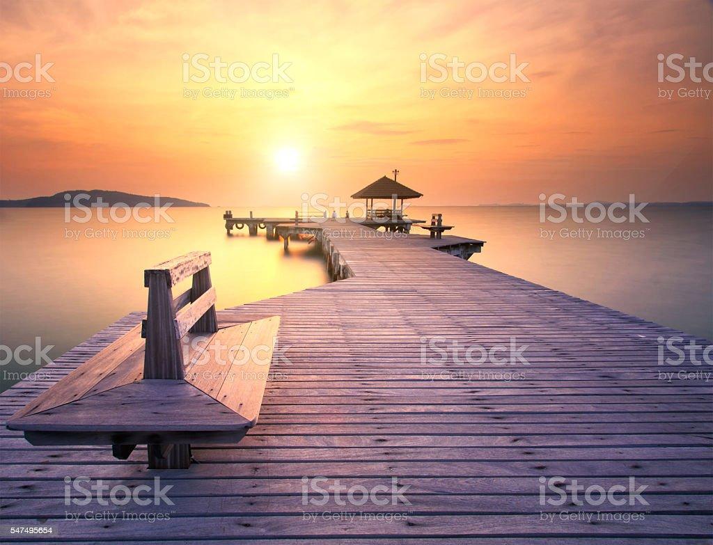 The long bridge over the sea with a beautiful sunrise stock photo