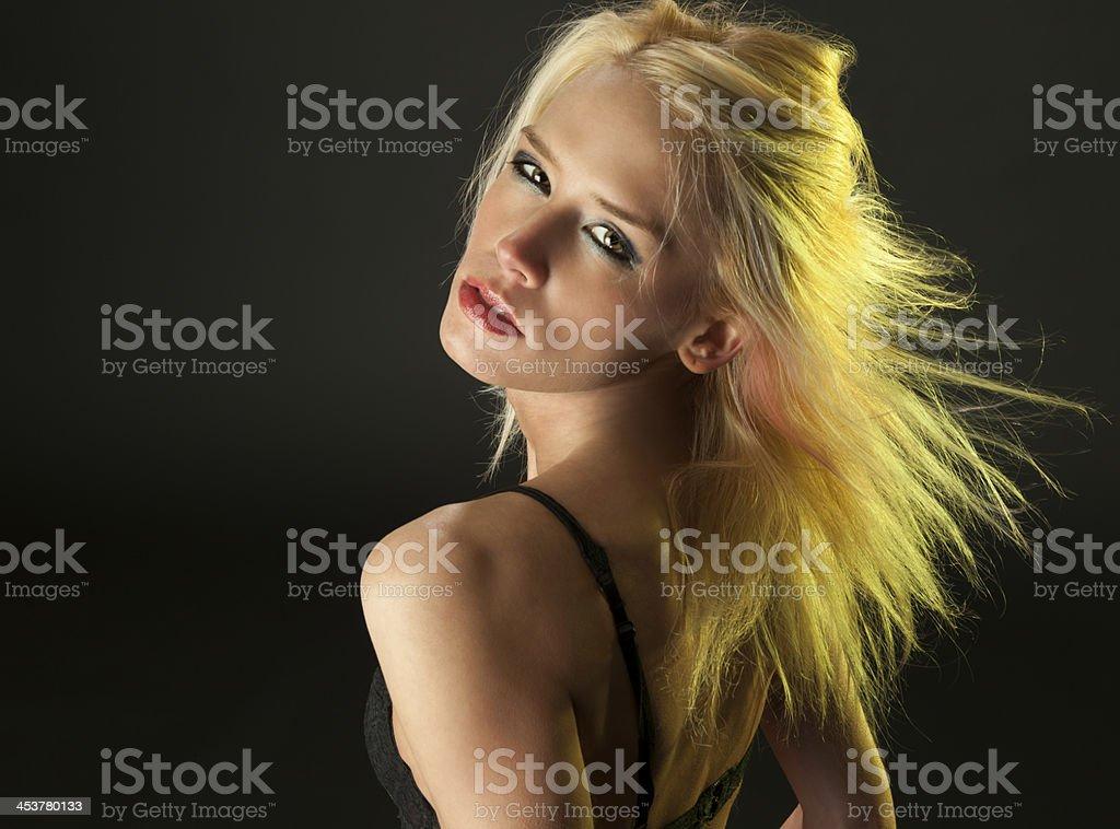 The Look; Blond Woman Turns Toward Camera, Intense Stare stock photo