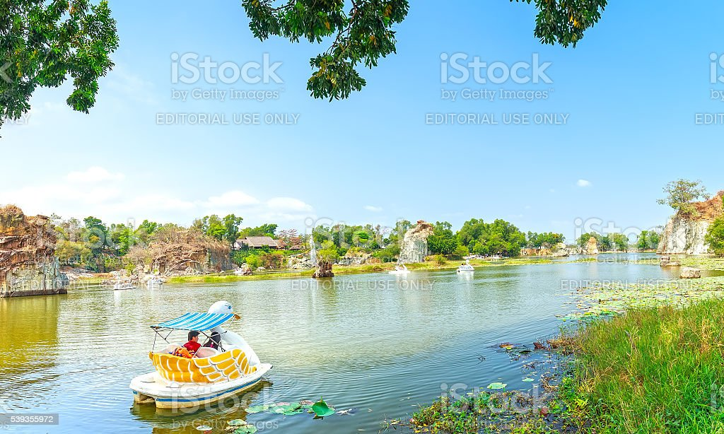 The lovers relaxing on a swan boat stock photo