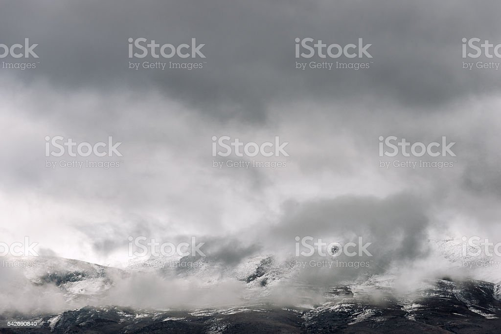 The low clouds over high mountains at winter day stock photo