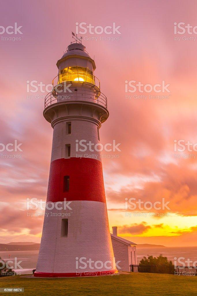 The Low Head Lighthouse illuminated at sunset stock photo