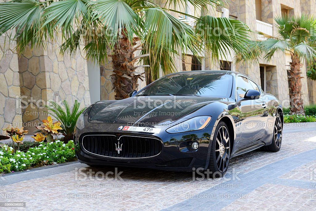 The luxury Maserati Granturismo car is near luxurious hotel stock photo