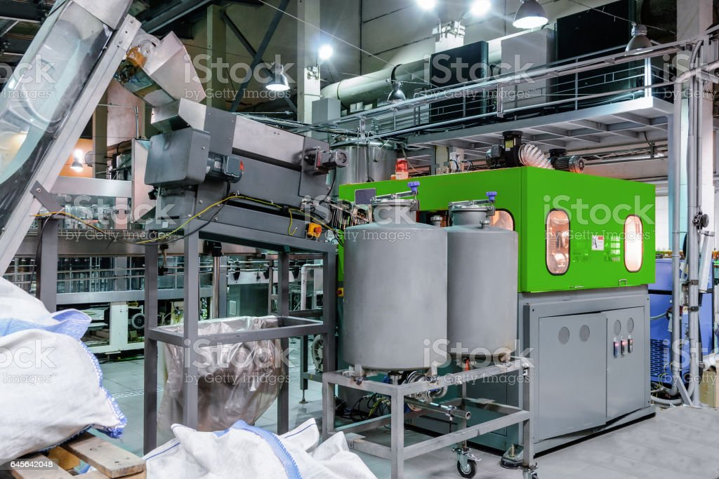 The machine for blowing plastic PET bottles stock photo