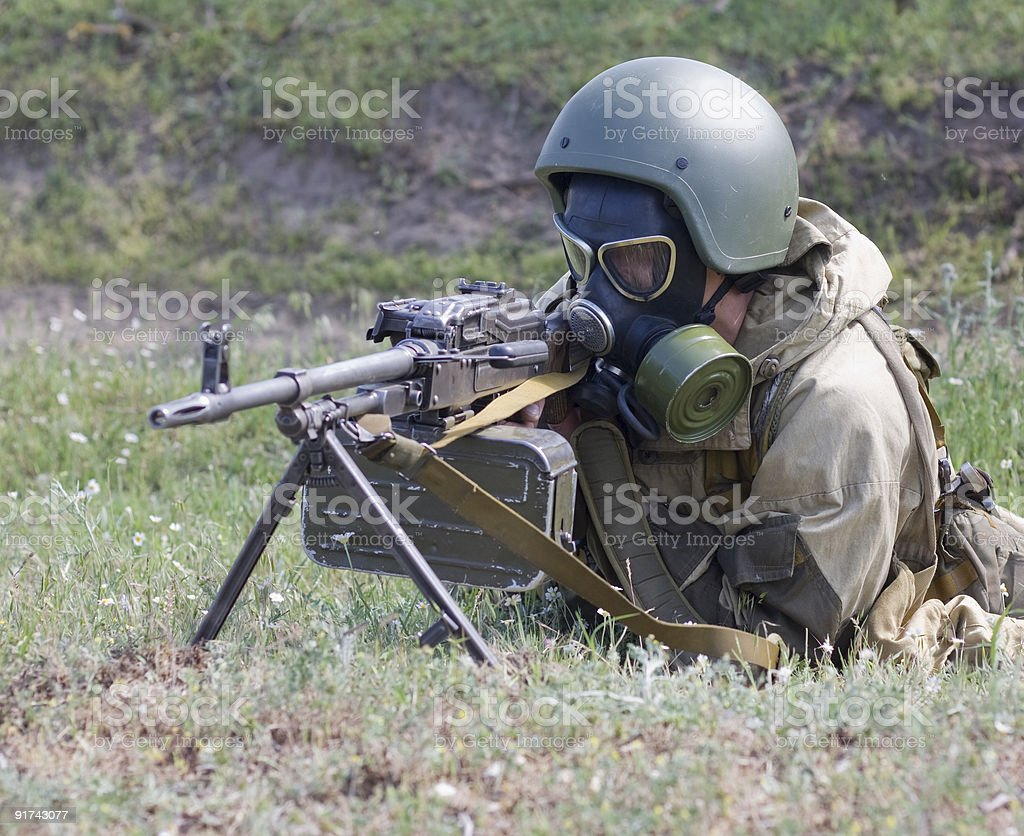 The machine gunner in a gas mask stock photo