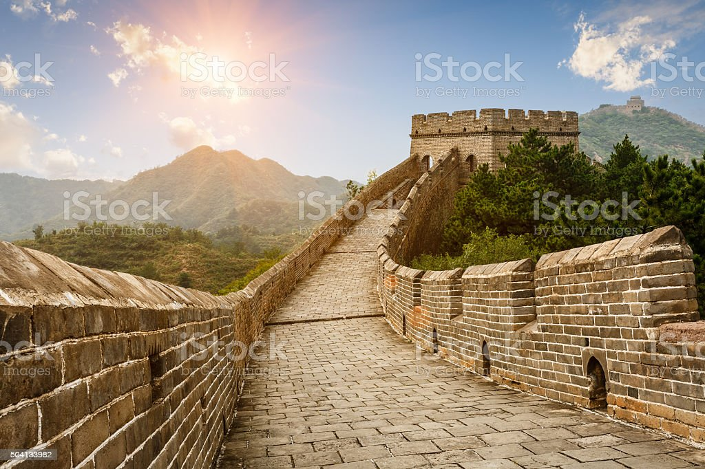 The magnificent Great Wall of China at sunset stock photo