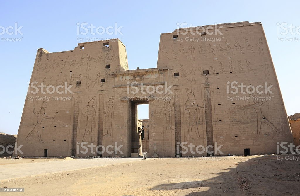The main entrance of Edfu Temple showing the first pylon. stock photo