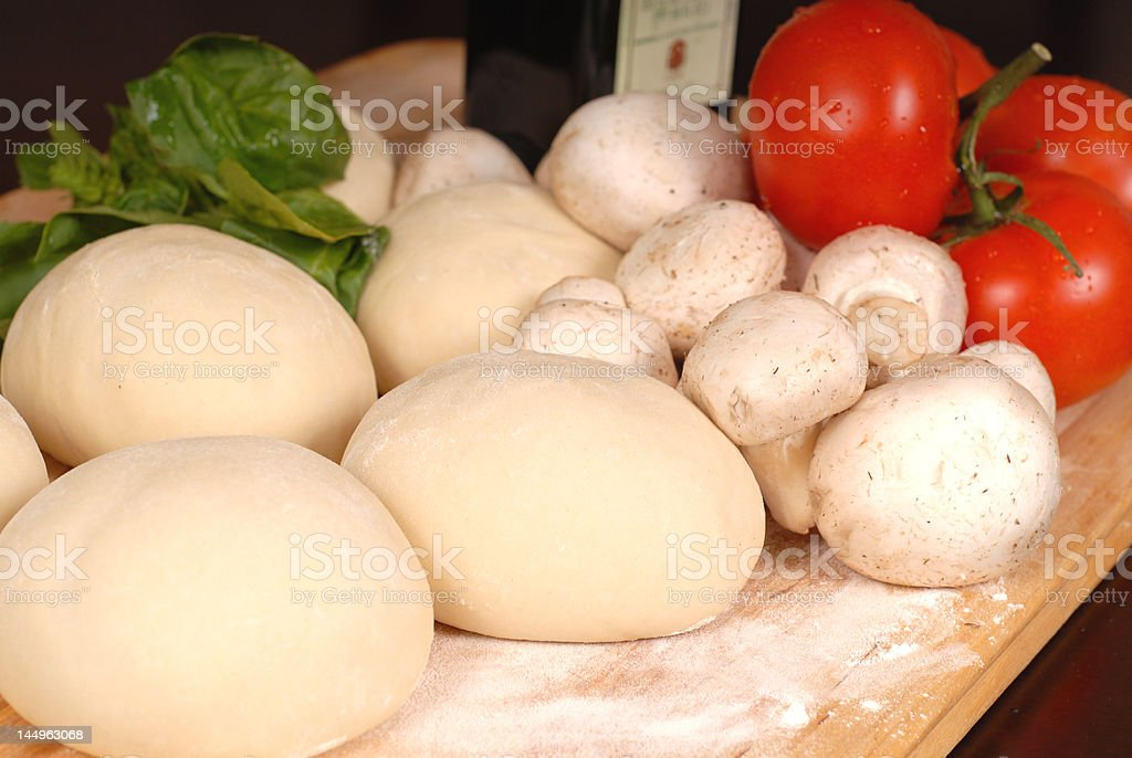 The makings for a fresh homemade pizza royalty-free stock photo