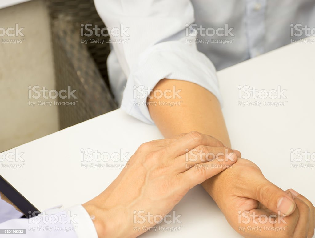 The male doctor on checking patient heartbeat stock photo