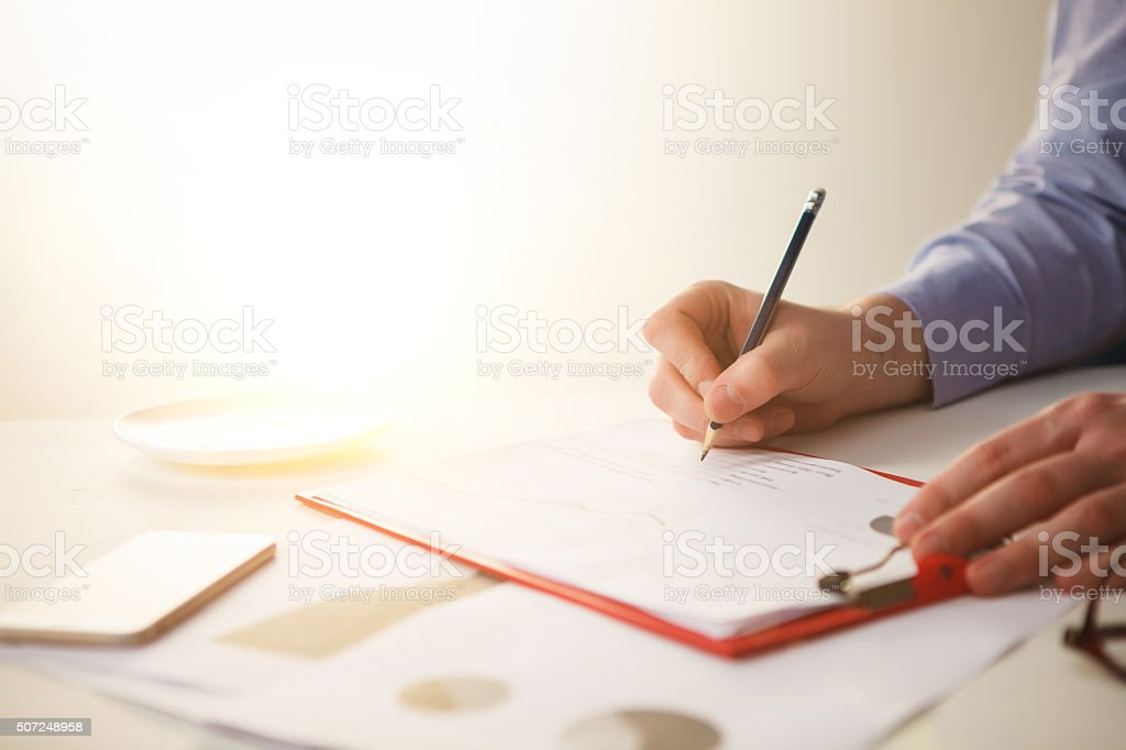 The male hand drawing a graph of growth stock photo