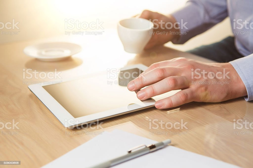 The male hands with a laptop and the cup stock photo