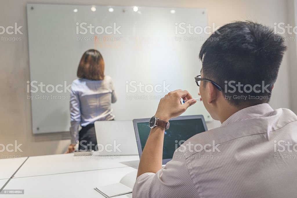 The man and his teammate seem ready for the brainstorming stock photo