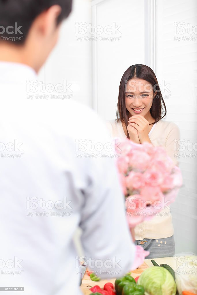 The man came home from work, sending flowers to woman. royalty-free stock photo