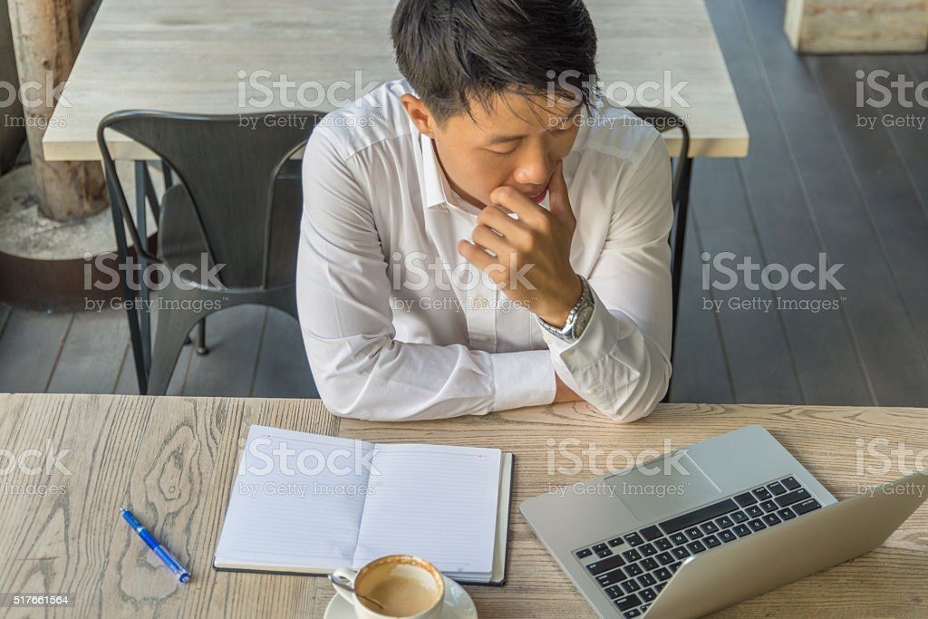 The man carefully read an important email from customer stock photo