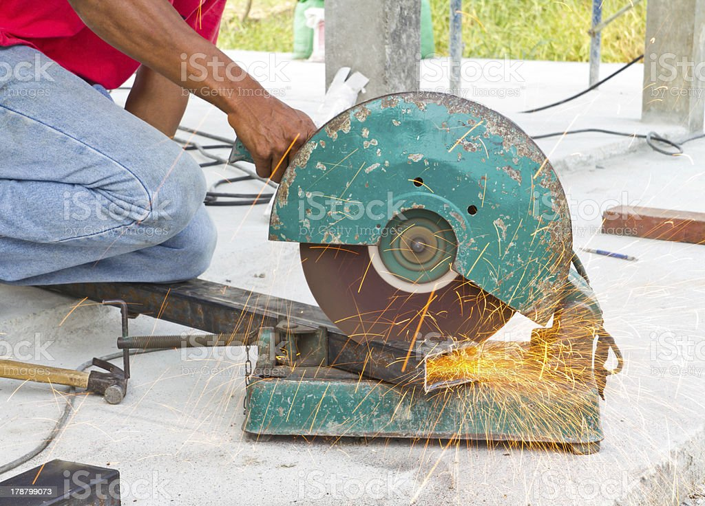 The man cutting metal royalty-free stock photo