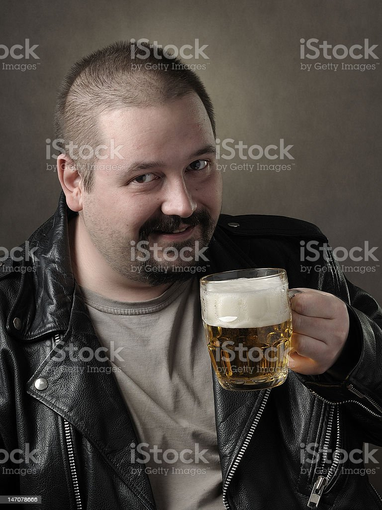 The man drinks beer from a mug stock photo