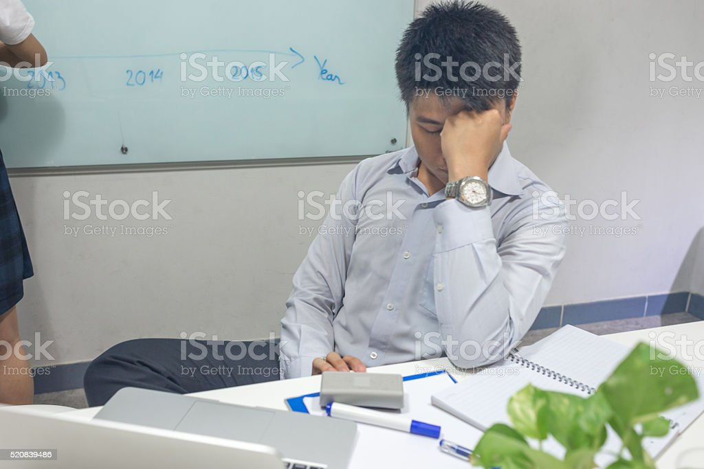 The man feel tired because the meeting last for hours stock photo