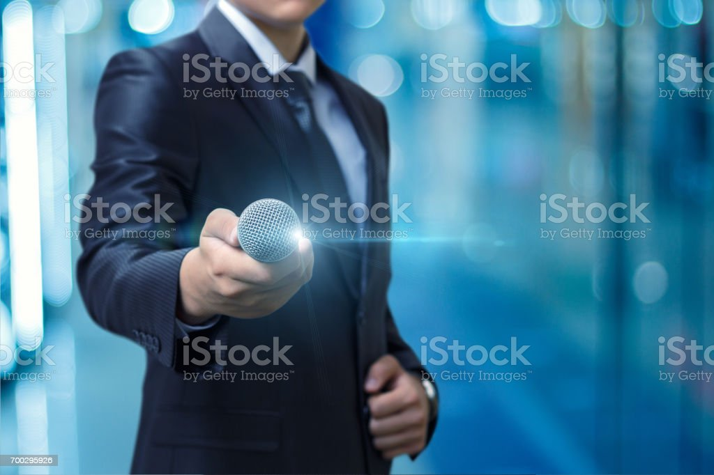 The man gives the microphone . stock photo