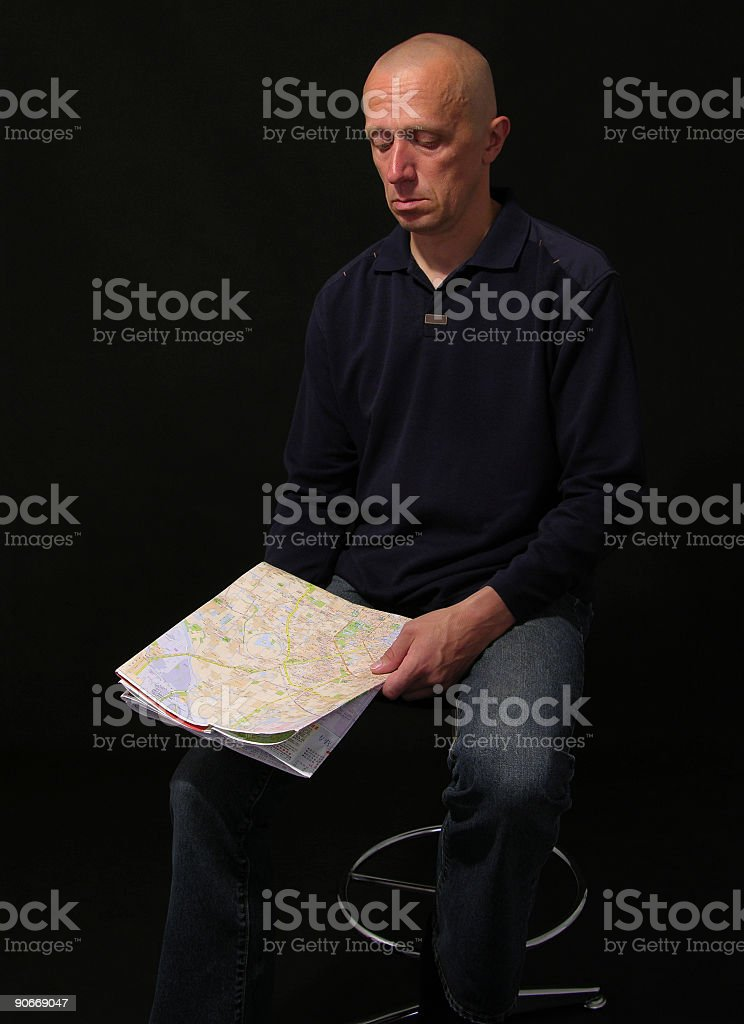 The man has thought of a map royalty-free stock photo