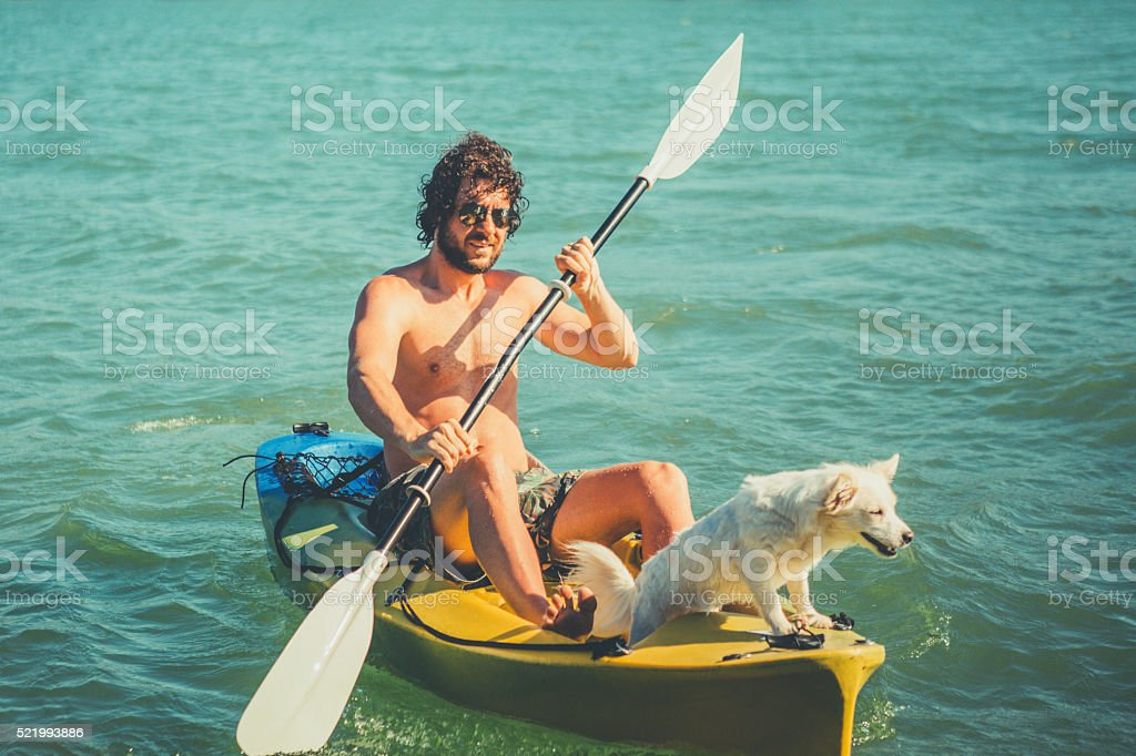 The man in a kayak  withhis dog stock photo