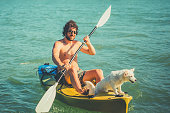 The man in a kayak  withhis dog
