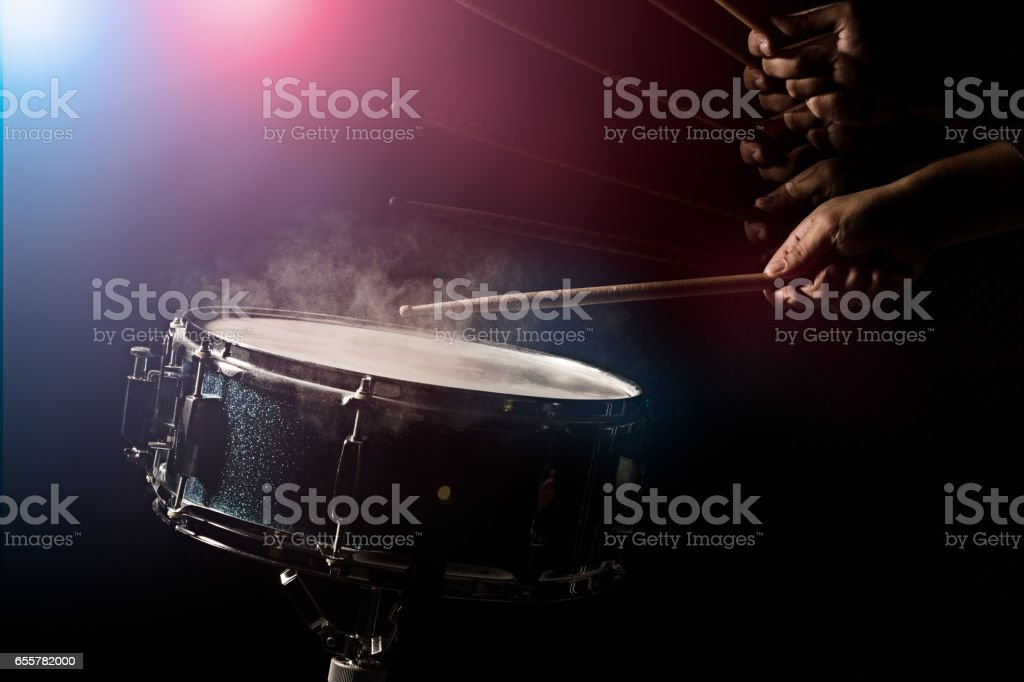 The man is playing snare drum stock photo