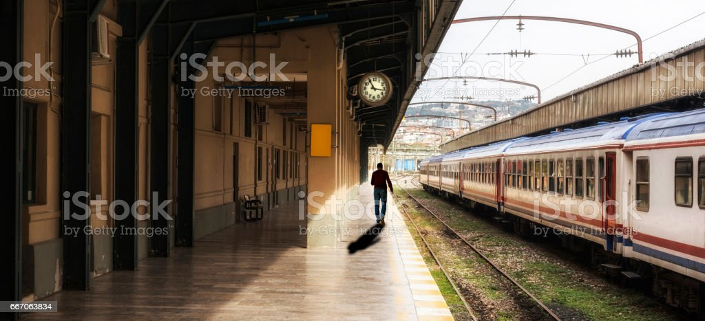 The man is waiting in railroad station platform stock photo