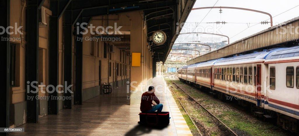 The man is waiting in railroad station platform at Haydarpasa,...