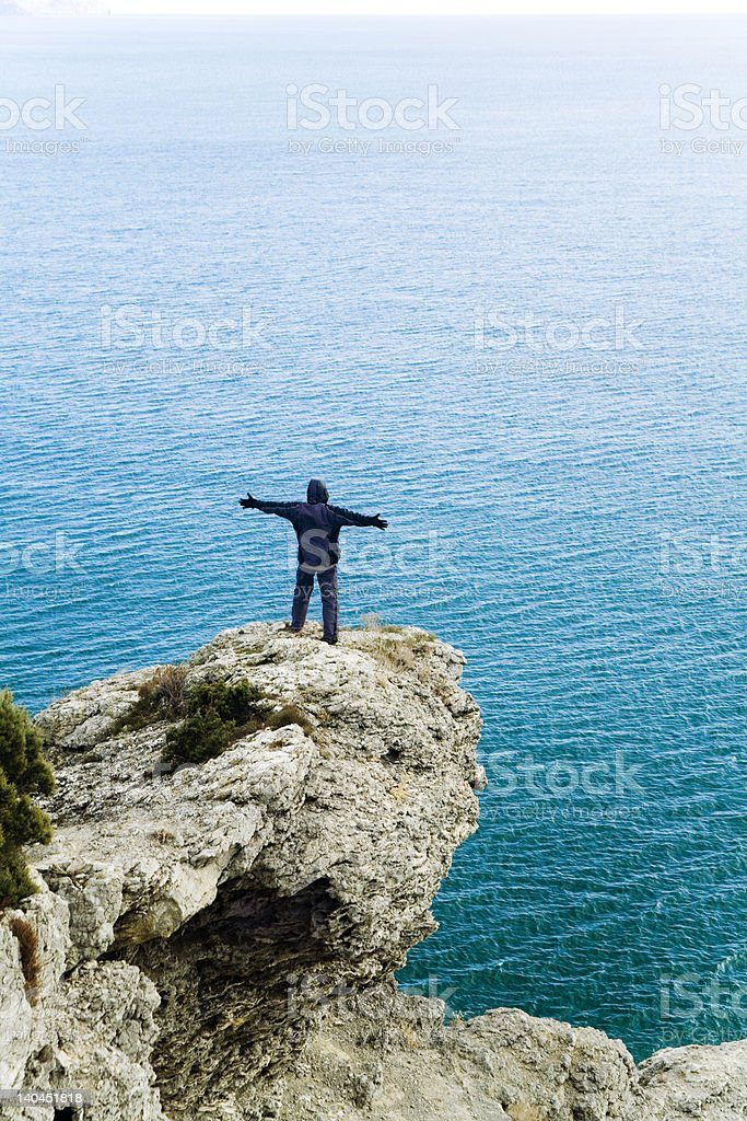 the man on a rock royalty-free stock photo