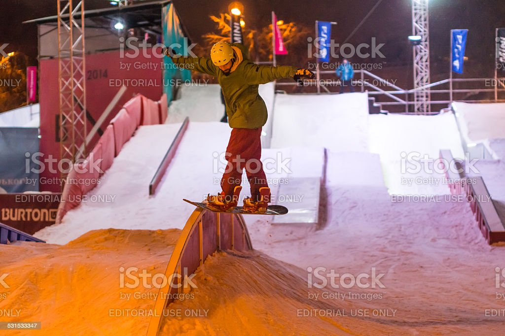 The Man on Snowboard in SnowPark. stock photo
