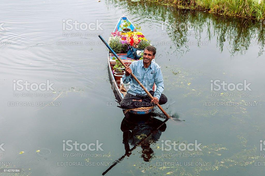 The man selling flowers, boat on Lake Dal, Srinagar,India. stock photo