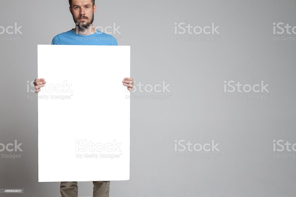 The man showing empty white billboard or banner stock photo