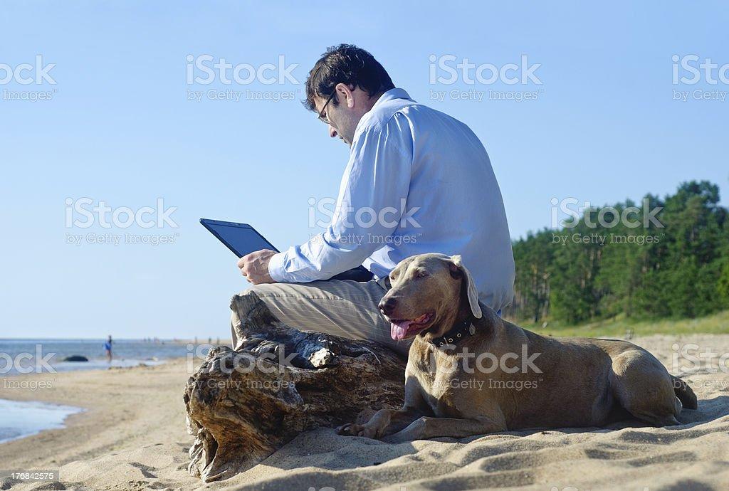 The man sits on seacoast royalty-free stock photo