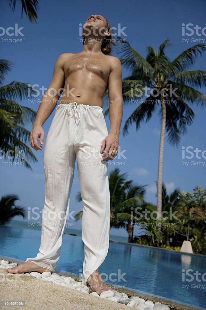 The man stand near swimming pool royalty-free stock photo