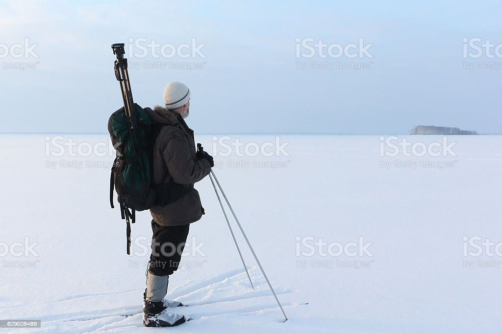 The man the photographer standing on snow on skis stock photo