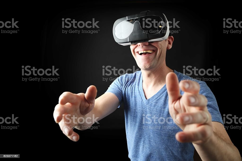 The man who plays with a virtual reality headset stock photo