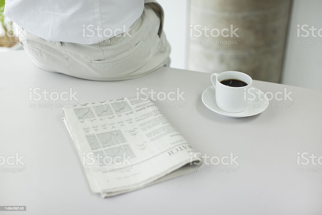 The man who sits down on a table royalty-free stock photo