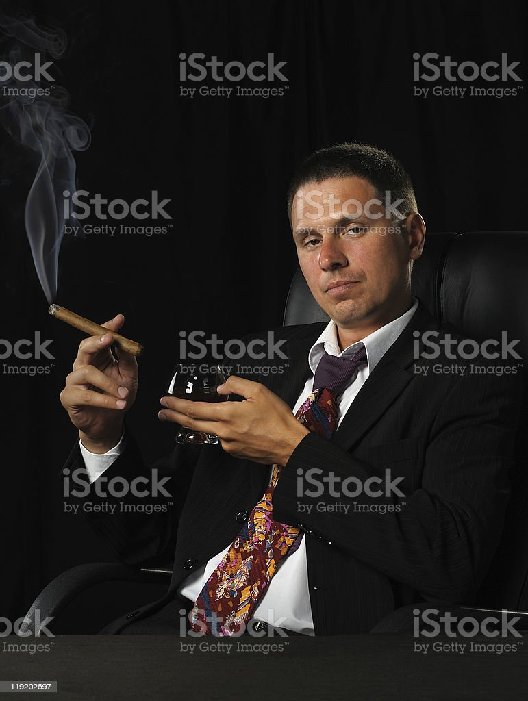 The man with a cigar and  glass of cognac royalty-free stock photo