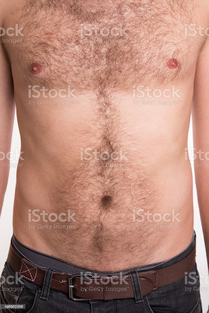 The man with hair on the chest and abdomen stock photo