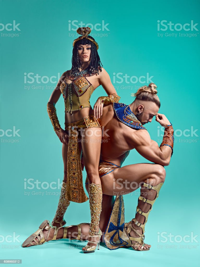 The man, woman in the images of Egyptian Pharaoh and stock photo